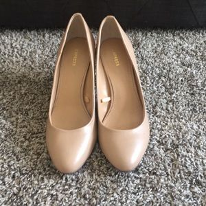 Nude pumps.